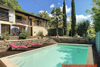 A 1970's detached house with 5 bedrooms, pool and land within walking distance of St Antonin-Noble-Val
